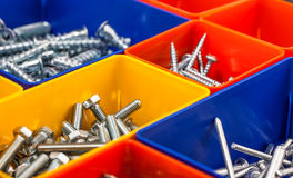 Screws located in a colorful box. Various  Screws located in a colorful box Royalty Free Stock Image