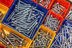 Screws located in a colorful box. Various  Screws located in a colorful box Stock Photo