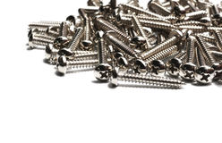 Screws located on a white background Royalty Free Stock Images