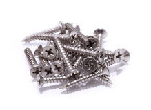 Screws located on a white background Stock Image