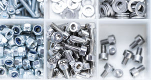 Screws and Machine Parts in a box. Screws and some other Machine Parts in a box royalty free stock image