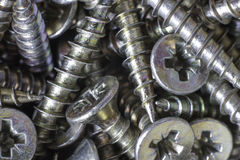 Screws. Macro of countersunk posidrive screws royalty free stock photos