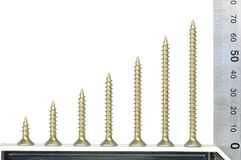 Screws and metal set square. Against white background Stock Photos