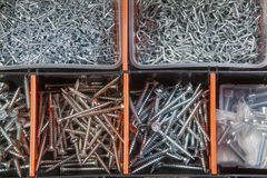 Screws and nails in a box Stock Images