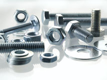 Screws and nuts. On a white background stock image