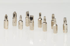 Screws, nuts, and bolts on isolated white background Stock Images