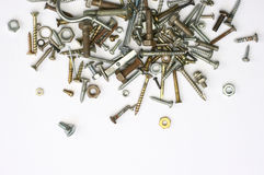 Screws, nuts and bolts. A pile of nuts,bolts, screws and other fasteners on a white background Royalty Free Stock Image