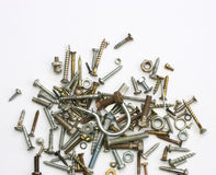 Screws, nuts and bolts. A pile of nuts,bolts, screws and other fasteners on a white background Royalty Free Stock Images