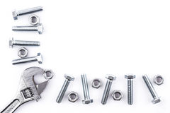 Screws, nuts and spanner on white background Stock Photos