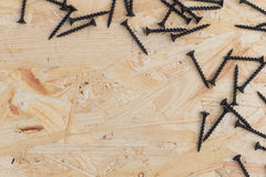 Screws on the osb plank top view.  background with copy Royalty Free Stock Photos