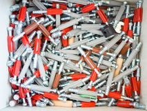 Close up screws pile in the wooden box. Screws pile in the wooden box Stock Images