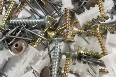Screws, plugs and nails Stock Images