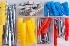 Screws and plugs in plastic toolbox, top view Stock Photography