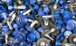 Screws roofing on a tree and metal, a Color hat with a rubber lining royalty free stock image