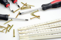 Screws, screwdriver and ruler Royalty Free Stock Photo
