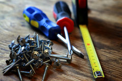 Screws and screwdriver stack Stock Images
