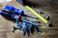 Screws and screwdriver stack Royalty Free Stock Images