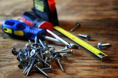 Screws and screwdriver stack Royalty Free Stock Photography