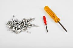 Screws and screwdrivers Stock Photos