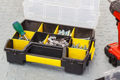 Screws in a storage box with screwdriver Stock Images