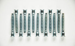 Screws, Ties, konfirmat lying symmetrically. Some ties on a white background Royalty Free Stock Image