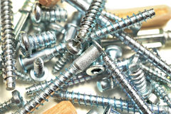 Screws and tools. Screws and work tools close-up Royalty Free Stock Images