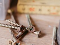 Screws in toolshop with yardstick in background royalty free stock photo