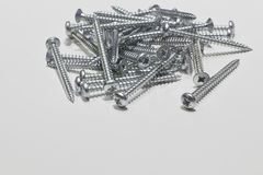 Screws  on a white background Royalty Free Stock Images