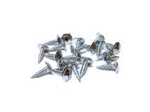 Screws on white background. Screws scattered on a white background Royalty Free Stock Images
