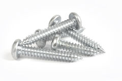 Screws on white Stock Photo