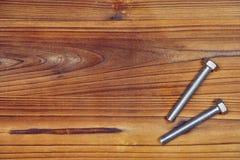 Screws on wood board. Royalty Free Stock Image