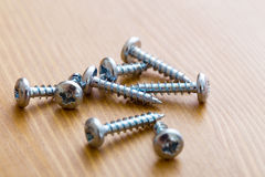Screws on wood Royalty Free Stock Photos