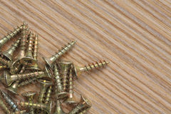Screws on a wooden background close up. Macro shoot Royalty Free Stock Photo