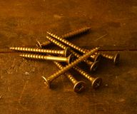 Screws on work table Royalty Free Stock Image