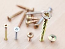 Screws wrapped in wooden floor Stock Photos