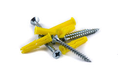 Screws and yellow plastic anchor Royalty Free Stock Images
