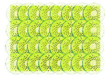 Scribble background with sliced kiwi Royalty Free Stock Images
