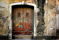 Scribble on old doors Royalty Free Stock Photography