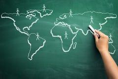 Scribble sketch of global business on blackboard Royalty Free Stock Image