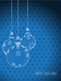 Scribbled christmas decorations on a blue background Stock Images