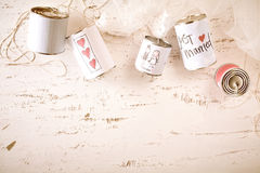 Scribbled love and marriage symbols on metal cans Royalty Free Stock Photos