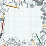 Scribbles of halloween monsters on desk with pencils background Royalty Free Stock Photo
