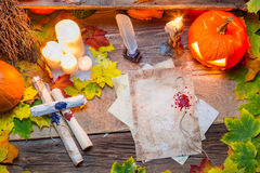 Scribe desk full of scrolls and candles Royalty Free Stock Images