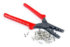 Scrimping pliers. Cable tube terminals, and scrimping pliers for electrical jobs, isolated on white with shadow Royalty Free Stock Photos