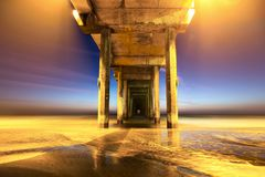 Scripps Pier below UCSD in San Diego after Sunset royalty free stock image