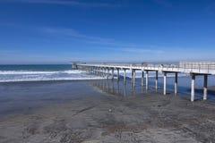 Scripps pier in California. Long concrete scientific pier at Scripps Institute of Oceanography in La Jolla, California extends far into beautiful ocean under Royalty Free Stock Photo