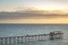 The Scripps pier and sunset on the horizon in California Royalty Free Stock Photography