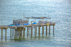 Scripps pier from a telephoto lens with a background of water Royalty Free Stock Images