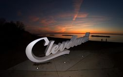 Script Cleveland sign overlooking Lake Erie at the Euclid Creek branch. An illuminated script Cleveland sign in the fore ground at Euclid Creek branch of the stock images