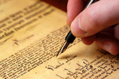 Script. Writing with narrow DOF on the pen tip Royalty Free Stock Images
